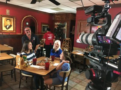 Shooting a commercial for local pizza restaurant.